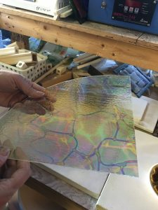 A quarter sheet of dichroic glass